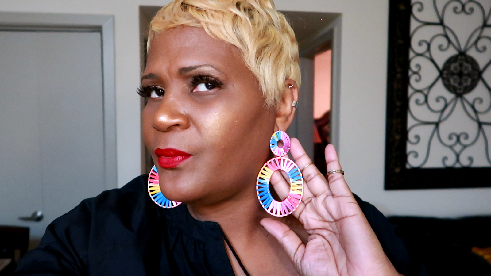 Image: Tangie Bell wearing her new rainbow earrings and showing them first on Bits and Babbles Blog