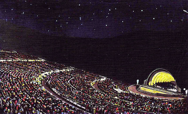 a 1939 amphitheater at night with a huge audience