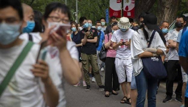 Pandemi Covid-19 di Xinjiang Meluas ke Dua Kota