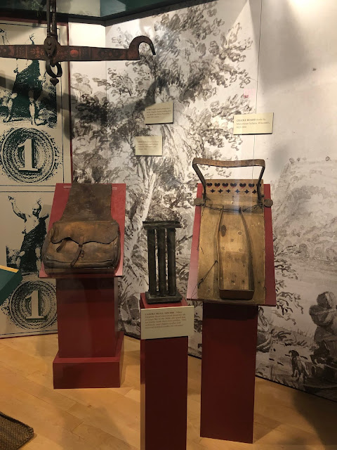 Artifacts from early settlement  and fur trading days including a cradle board, candle maker and saddle bag at the Wisconsin Historical Museum.