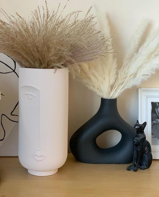 black donut vase with modern face vase