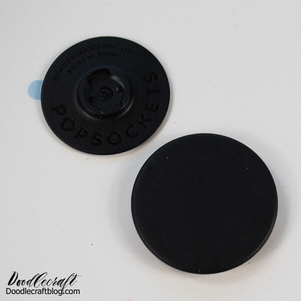 STEP 1: Begin by twisting the top of the pop socket off the base. Place the top on a disposable work surface.