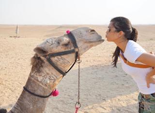 "kourtney kardashian kisses ""camel"" at the Pyramids during her visit to Egypt"