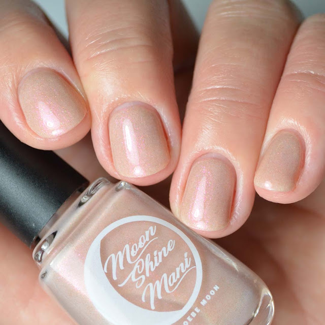 peach shimmer nail polish four finger swatch