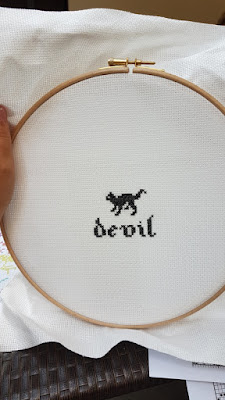 cross stitch embroider black cat and name of the cat, devil