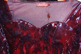 the bustier neckline of a velvet navy dress by motelrocks, on the hanger