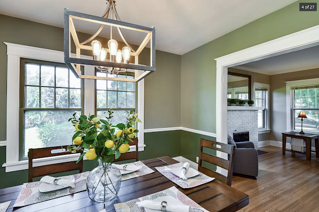 color photo of dining room with windows of Sears Kilbourne at 409 Wing Park Blvd, Elgin, Illinois