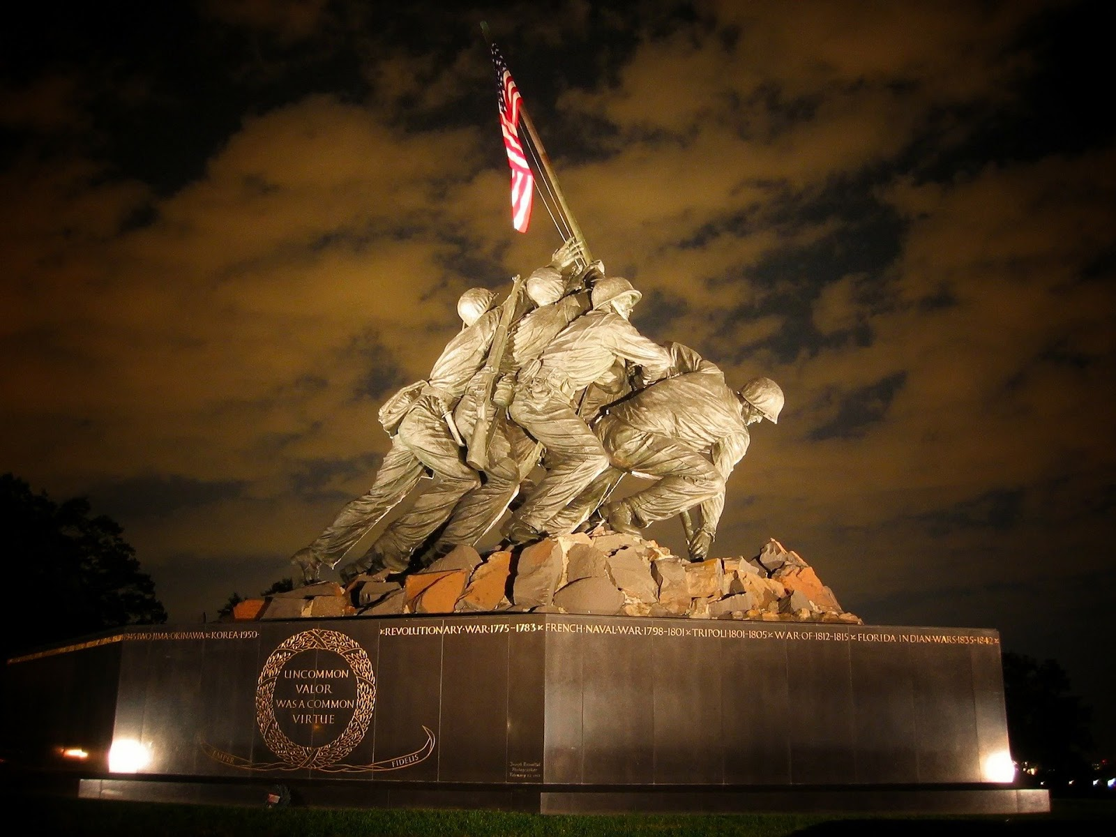 the mariine corps iwo jima memorial at night for blog post about the marine corps birthday