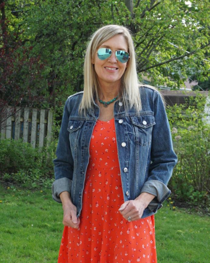denim jacket layered over sundress