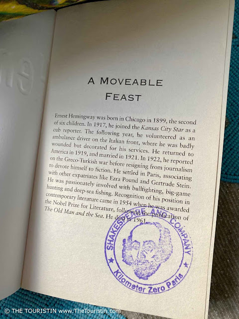 The first page of the book A Moveable Feast by Ernest Hemingway with a postmark/seal from the bookshop Shakespeare and Company in Paris in France.