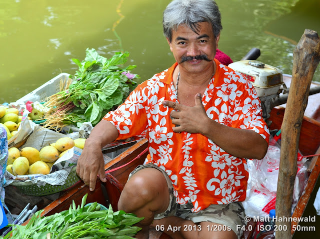 people, street portrait, eye-level camera angle, Thailand, Bangkok, Khlang Latmayom Floating Market, floating market, boat vendor, fresh vegetable