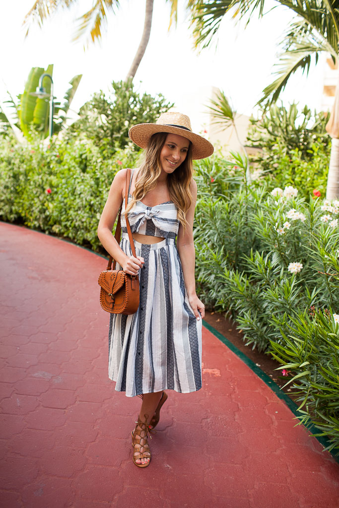 A striped midi dress topped with a bow.
