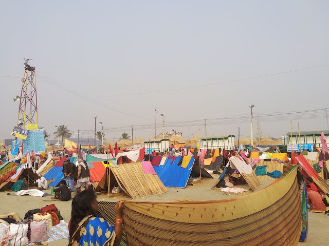 Pilgrims taking shelter on Temporary Hogla Hut constructed on Sea Beach