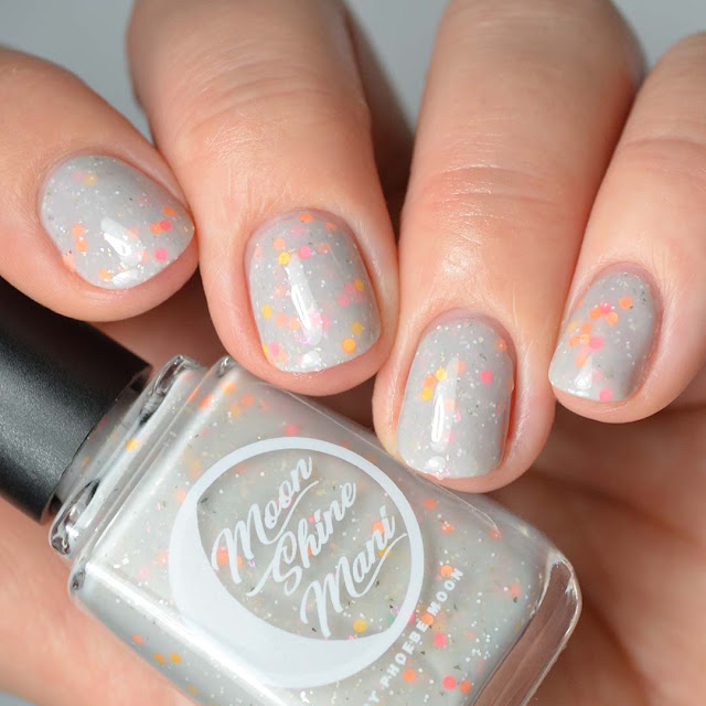 grey nail polish with silver flecks and citrus glitter