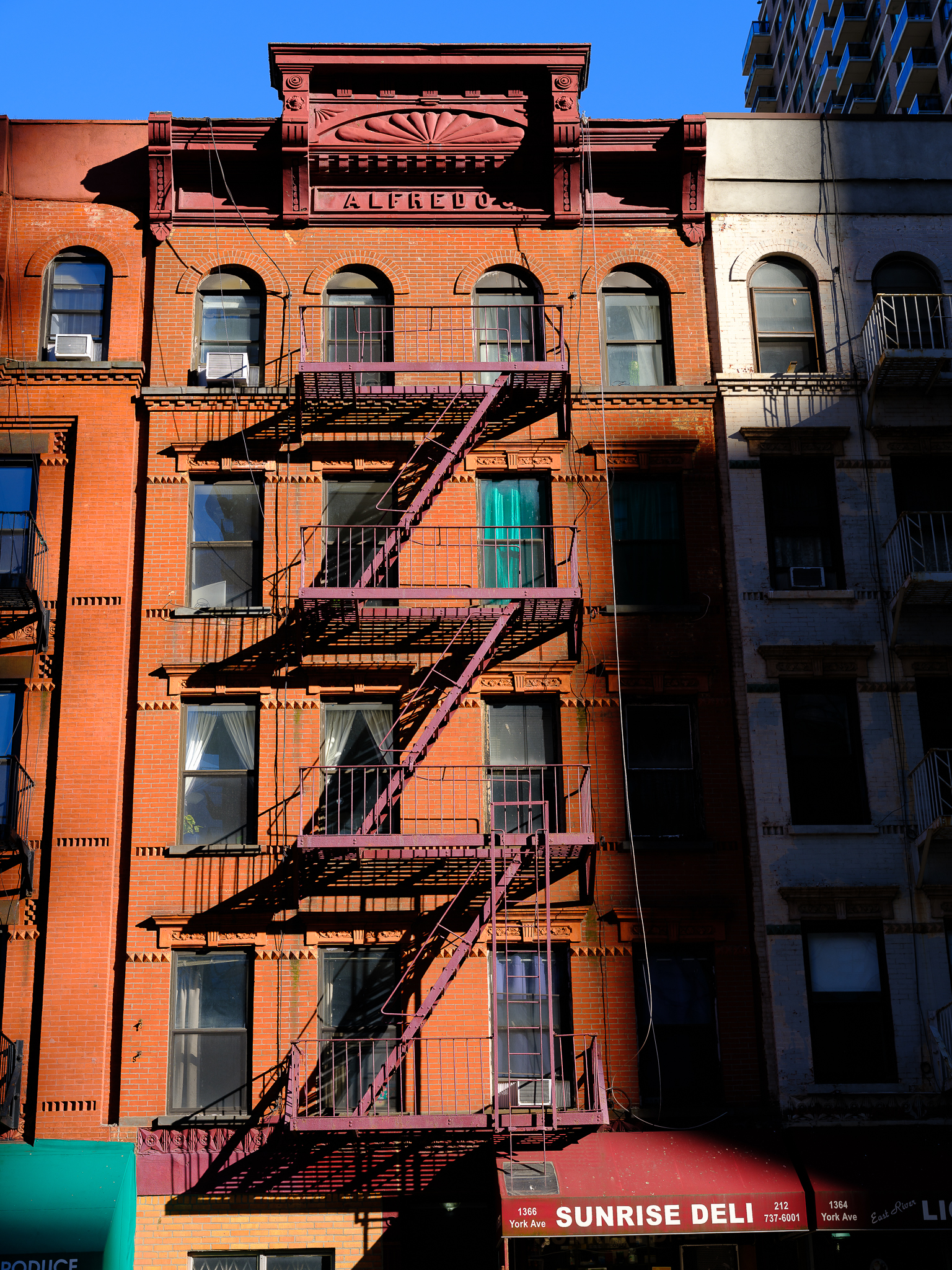 a photo of bricks and fire escapes in manhattan