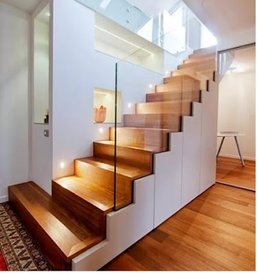 wooden staircase design with glass handrails