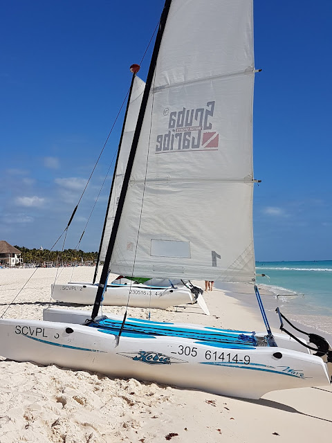 catamaran on sandy beach in Caribbean