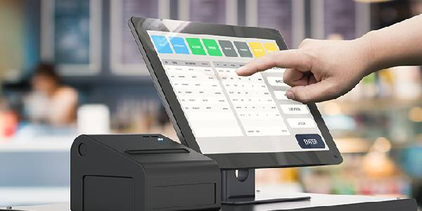 A Business Person Operating the POS Software for his Business.