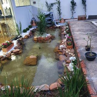 kolam relief air terjun