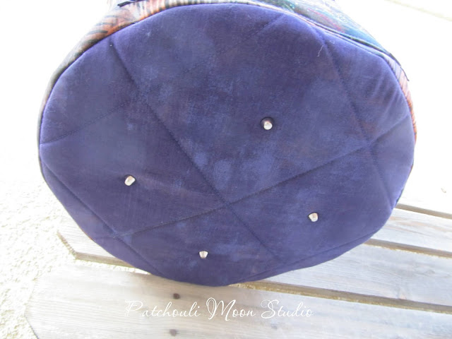 View of the quilted bottom of the bag with added purse feet