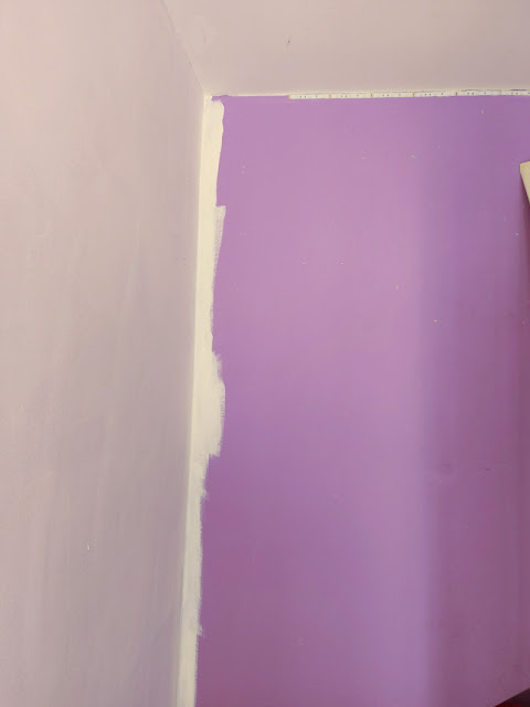 A purple wall - the adjoining wall has been painted white