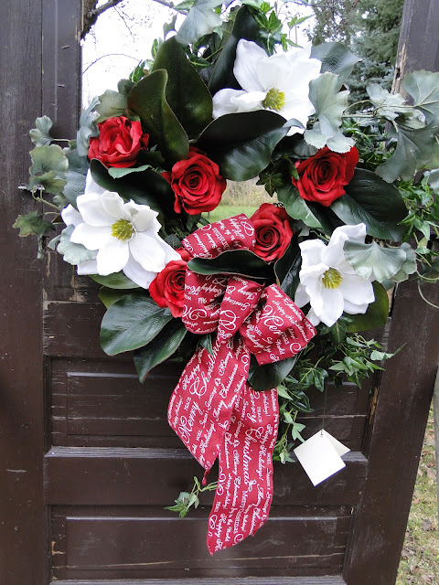 white magnolia and red roses wreath