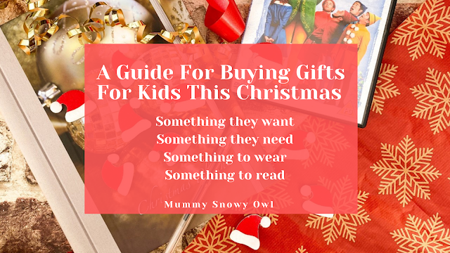 A festive flatlay with the text, A Guide For Buying Gifts For Kids This Christmas as the rhyme, something they want, something they need, something to wear, something to read