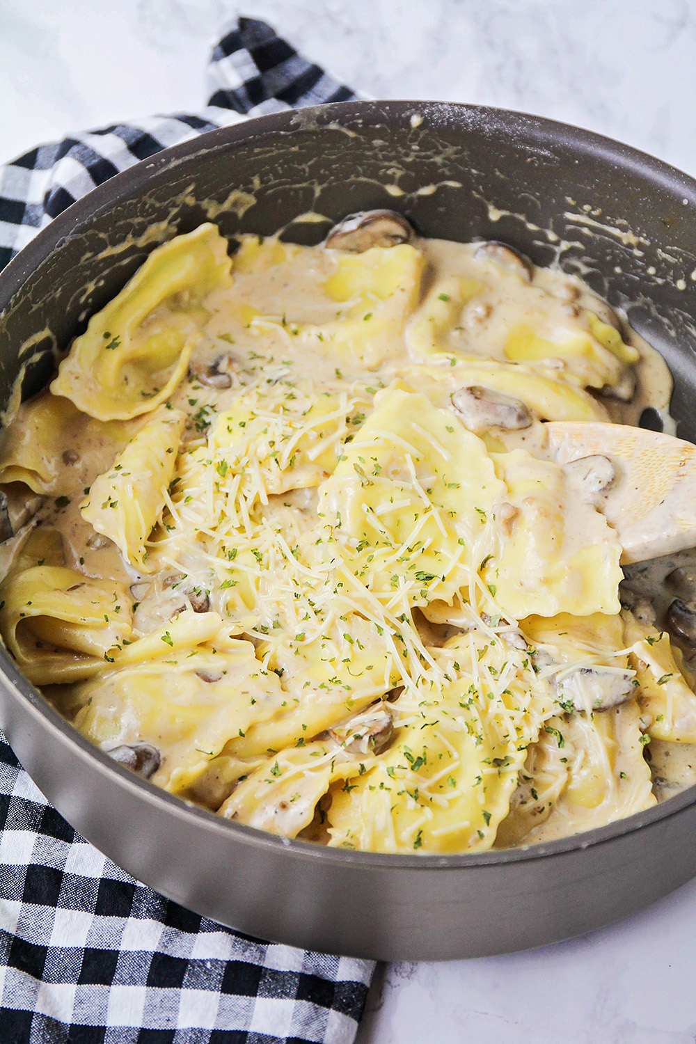 This savory ravioli with mushroom cream sauce is a flavorful and delicious meal that's ready in 30 minutes!