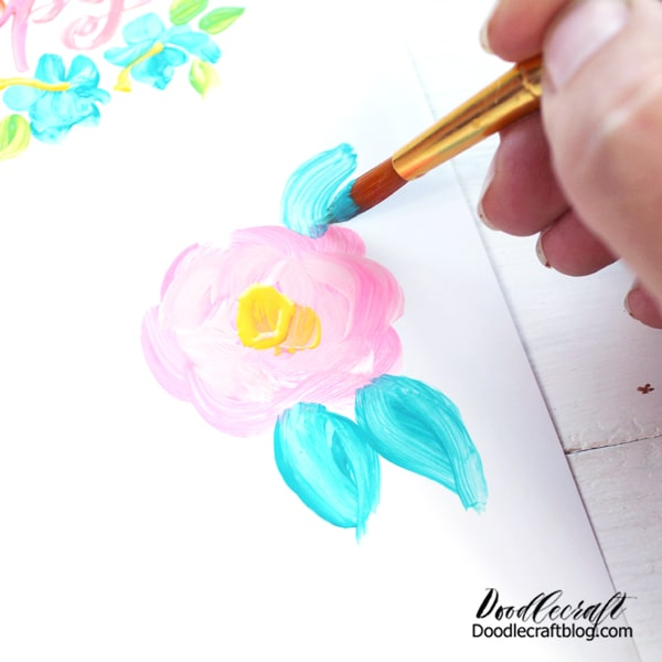 """When painting flowers, make big """"C"""" shaped blobs of paint in a circle. These form the petals. Then add some lighter and darker paints. Paint leaves and add some paint, in this case, yellow to the center of the flowers."""