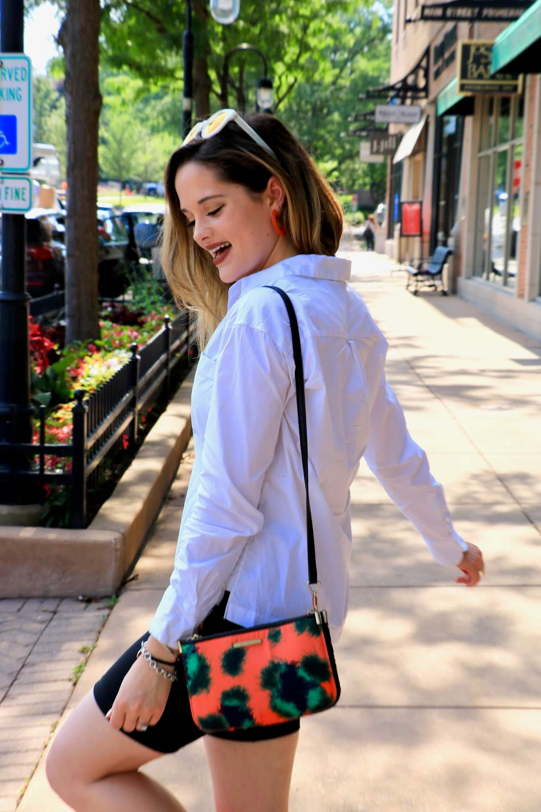 Nyc fashion blogger Kathleen Harper wearing a white blouse summer outfit.