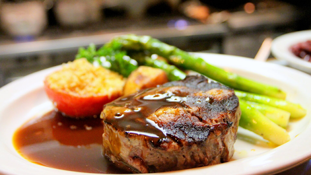 a thick cut steak smothered in brown gravy