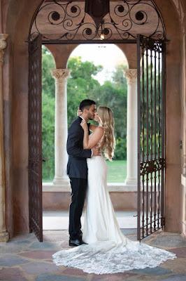bride and groom photos in doorway of the howey mansion