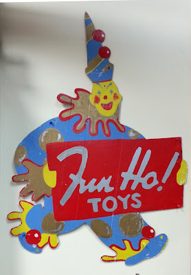 Fun Ho! logo of a clown carrying a sign with 'Fun Ho! toys' written on it.