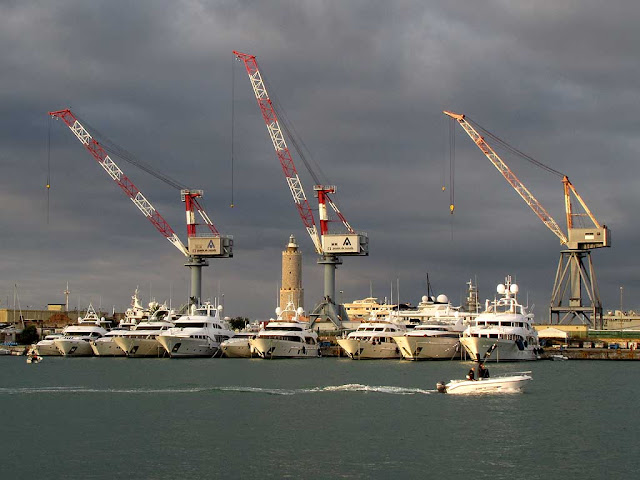 Three cranes, the lighthouse and many yachts, port of Livorno