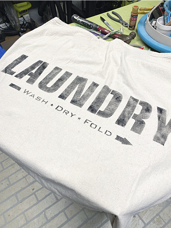 stenciled laundry sign