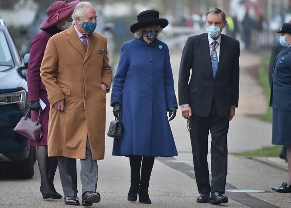 The Duchess of Cornwall wore a blue wool coat, and wears a face mask