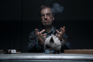 Bob Odenkirk sitting at a table with a kitten