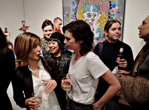 Sculptures and a multi-eye head painting. Opening night crowd at Roslyn Oxley9 gallery for 'angel dribble' by Del Kathryn Barton.