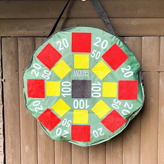 The inflatable target hanging from a wooden door
