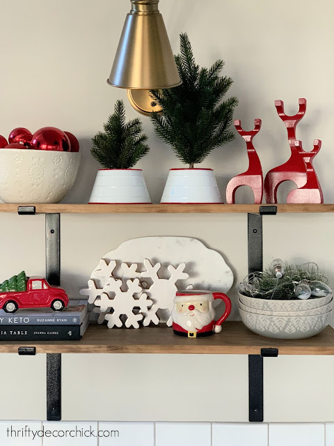 Christmas decor on kitchen shelves
