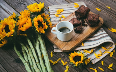interior inspiration image of sunflowers, bread and coffee