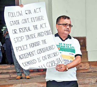 Kurseong MLA Rohit Sharma holds up a Gorkhaland poster outside the Assembly