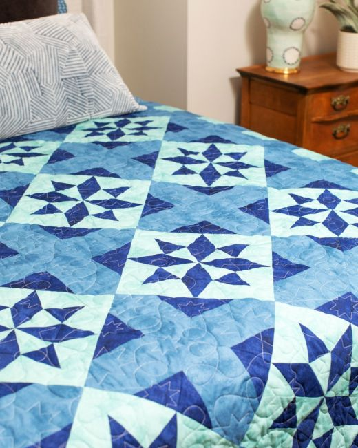 Morning Star Blues Throw Quilt designed by Accuquilt