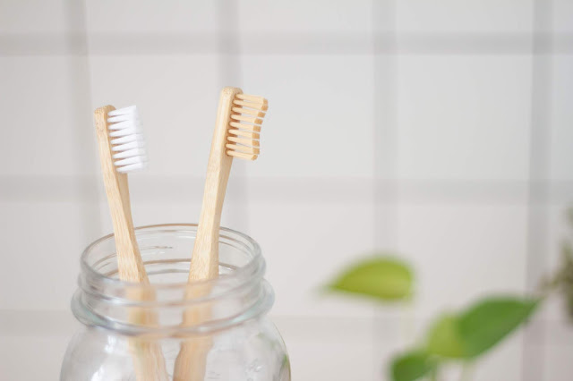 toothbrushes in jar.Photo by Superkitina on Unsplash