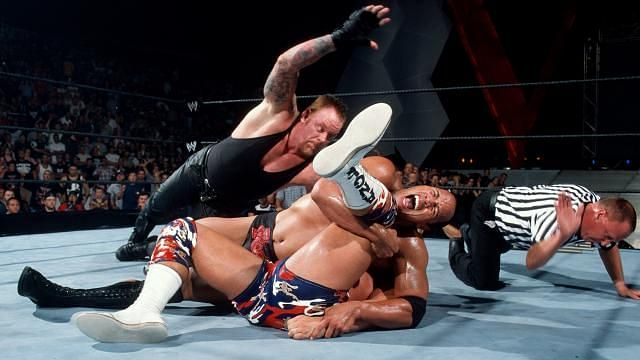 The Undertaker interrupting The Rock's pinfall