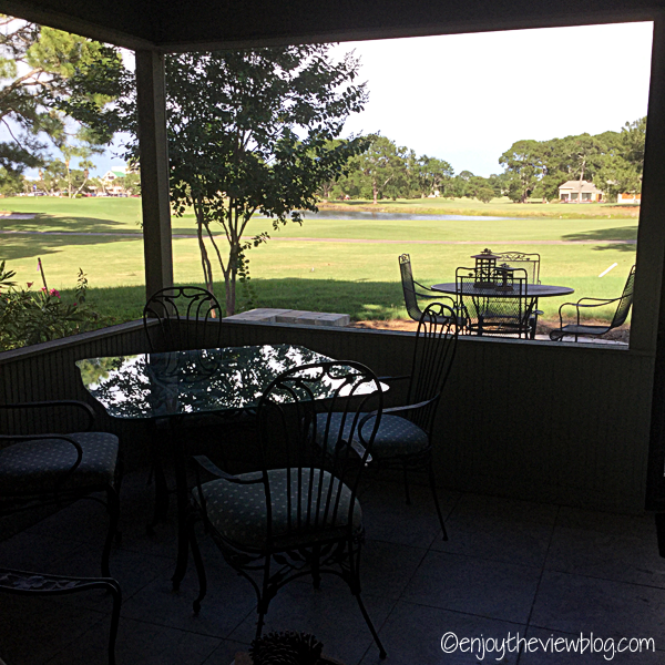 view of golf course from screened porch