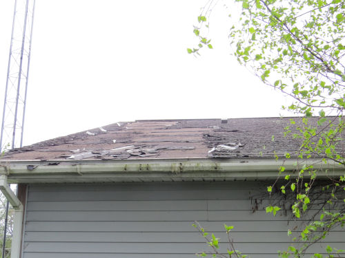 roof partially cleared of shingles