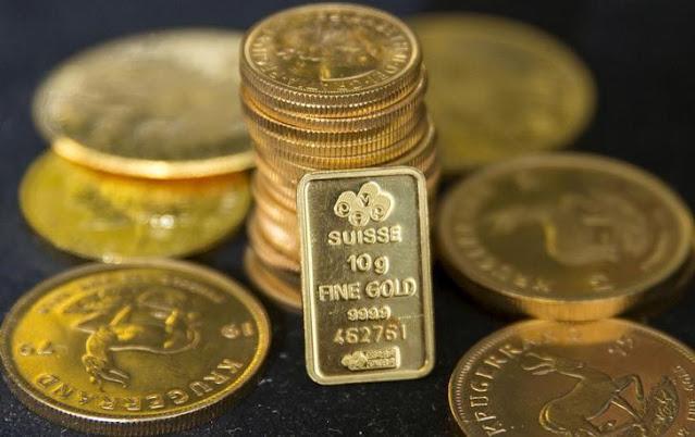 El oro cae y el dólar sube