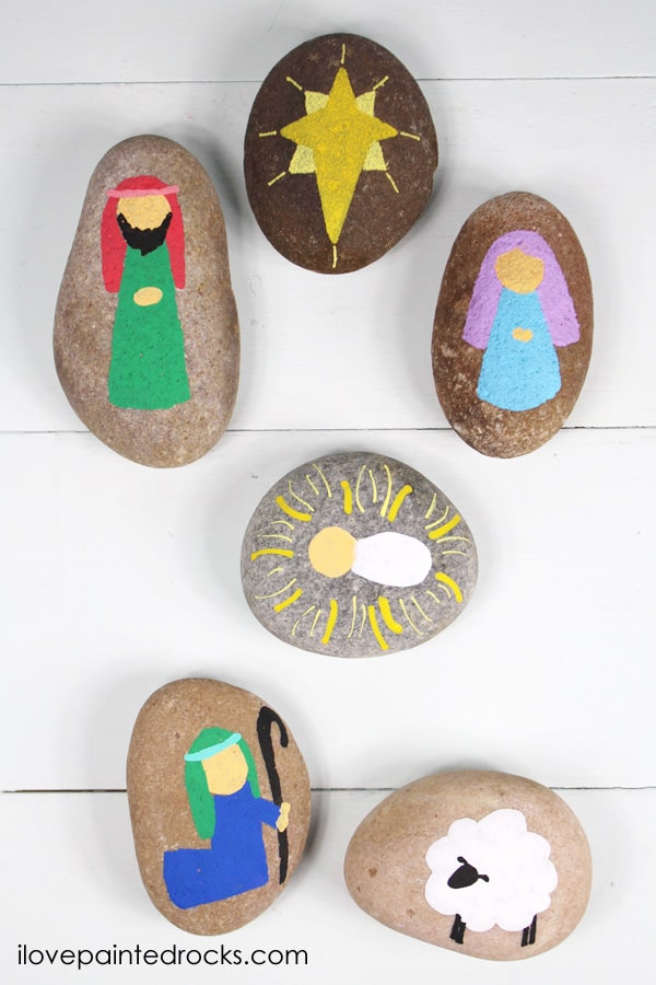 Christmas rock painting idea: a simple painted rock nativity set is a great family craft to do with kids while discussing the Christmas story
