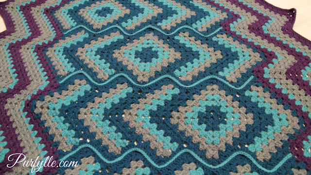 'Drops in the frog pond' large crochet rug the sections are joined with a zipper join